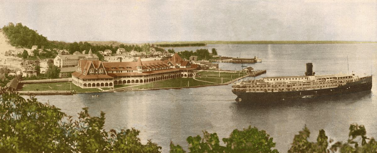 Hotel Ottawa at the base of Mt. Pisgah with one of the steamers that regularly brought passengers to Ottawa Beach